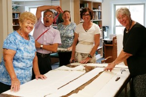 Members of ARCWP, Albany, NY in the Upper Room following liturgy; making white stoles, August, 2015
