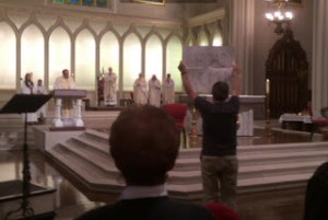 Robert Eiden standing up for women's ordination in the Louisville Cathedral, March 28, 2016 https://www.courier-journal.com/story/news/religion/2016/03/28/louisville-cathedral-protester-ordain-women/82336602/
